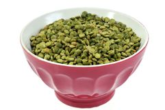 Bowl of split peas on a white background royalty free stock photography