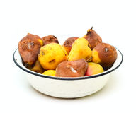 Bowl with spoilt pear Royalty Free Stock Photos
