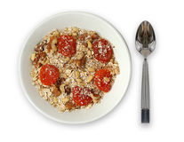 Bowl and spoon. Bowl of oats with fruits and nuts. And a spoon Stock Photo