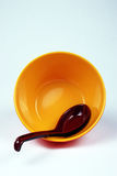 Bowl with spoon Stock Images