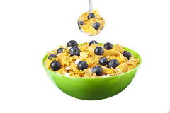 Bowl and spoon of cereals Stock Photography