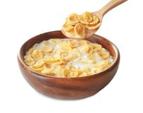 Bowl and spoon with corn flakes and milk Royalty Free Stock Photography