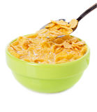 Bowl and spoon with corn flakes. On the white background Stock Photo