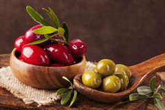 Bowl and spoon with olives Stock Photography