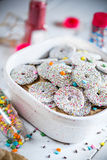 Bowl of sprinkled holiday cookies. On a party table royalty free stock photography