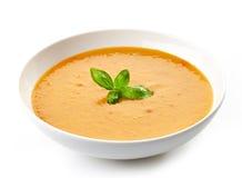 Bowl of squash soup with basil Stock Photos