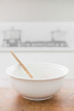 Bowl standing on table Royalty Free Stock Image