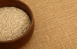 Bowl Of Steel Cut Oatmeal On Burlap Bag Royalty Free Stock Photo