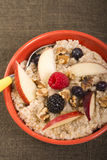 Bowl of steel cut oats served with fresh fruit and Stock Photos