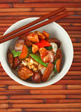 Bowl of Stewed Chicken over White Rice Stock Photography