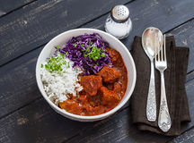 Bowl of stewed meat, rice and red cabbage. Tasty healthy food. Stock Photos