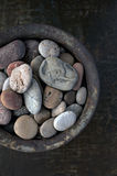 Bowl Of Stones. River stones collected in a rust bowl Royalty Free Stock Photography