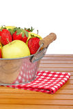 Bowl of strawberries and apples Stock Image