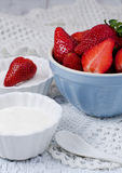Bowl of Strawberries and Cream. Delicious refreshing bowl of ripe red fresh strawberries and cream Royalty Free Stock Image