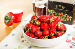 Bowl of strawberries with jam and recipe box Stock Photo