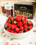Bowl of strawberries with jam and recipe box Stock Photos