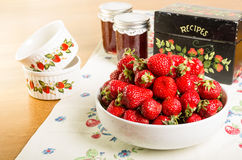 Bowl of strawberries with jam and recipe box Royalty Free Stock Image