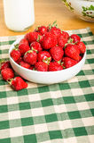 Bowl of strawberries with milk Royalty Free Stock Photography