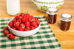 Bowl of strawberries with milk and jelly Stock Image