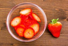 Bowl with strawberries over wooden top Royalty Free Stock Photography