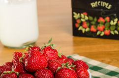 Bowl of strawberries with recipe box Stock Image