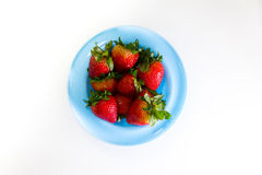 A Bowl Of Strawberries. On a table royalty free stock image