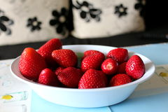 Bowl of strawberries on table Stock Images