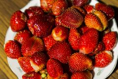 Bowl of strawberries top view. On wooden table stock images