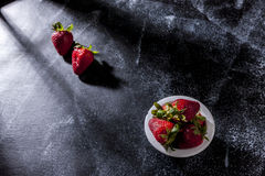 Bowl of strawberries by the window. Stock Photography