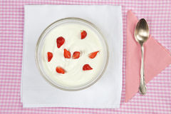 Bowl with strawberries in yogurt. Bowl with fresh strawberries in yogurt with silver spoon Stock Images