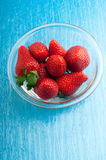 Bowl with strawberry Stock Images