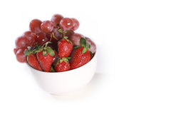 A bowl with strawberry and grapes Royalty Free Stock Photography