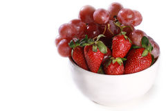 A bowl with strawberry and grapes Royalty Free Stock Image