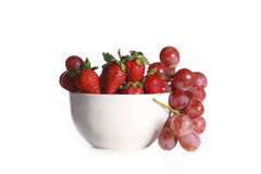 A bowl with strawberry and grapes Stock Photo