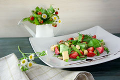 Bowl of strawberry salad on the table Royalty Free Stock Photo