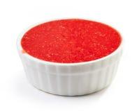 Bowl of strawberry sauce Stock Photos