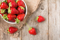 Bowl with strawberry on wooden background Royalty Free Stock Photo