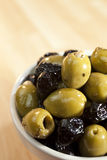A Bowl of Stuffed Green and Black Olives Stock Photo