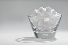 Bowl of sugar. Glass bowl filled with sugar cubes stock images