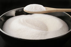 Bowl of sugar with spoon Royalty Free Stock Photo