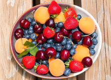 Bowl of summer  fruits and berries. Royalty Free Stock Images