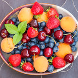 Bowl of summer  fruits and berries. Stock Photo