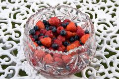 Bowl of summer fruits on an outdoor table Royalty Free Stock Photos