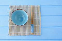 Bowl for sushi and chopsticks on the Makis Royalty Free Stock Image