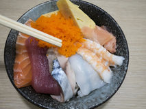 A bowl of sushi don. A bowl of japanese styled rice topping with fresh salmon, tuna, squid and boiled shrimp Stock Images