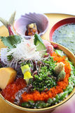 Bowl of sushi sashimi with red eggs, wasabi, fish and seaweed so Stock Photo