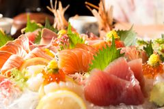 Bowl of sushi  with tuna salmon oyster and shrimp. On wooden table Stock Photo