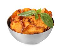 Bowl of sweet potato chips with basil isolated. On white royalty free stock photo