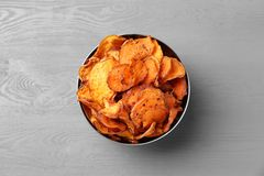 Bowl of sweet potato chips on grey table. Top view royalty free stock photography