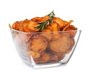 Bowl of sweet potato chips with rosemary on white. Bowl of sweet potato chips with rosemary isolated on white stock photography